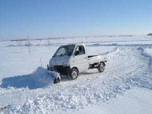 Picture of 93 Suzuki Carry plowing snow